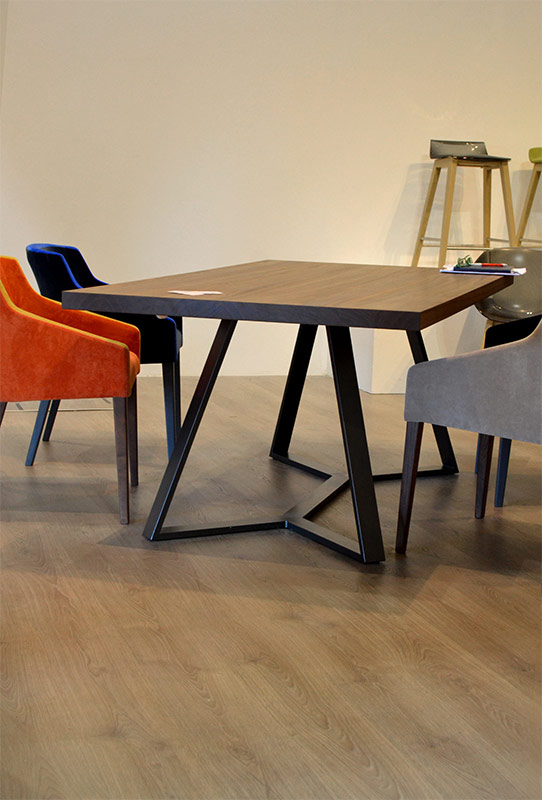The cubist style geometric shapes of this table are reminiscent of Hadid's modern aesthetic