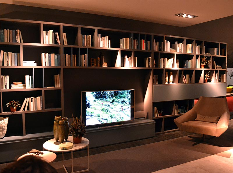 A shelving unit in a similar shade as your wall gives the room a contemporary feel while enhancing the illusion of space
