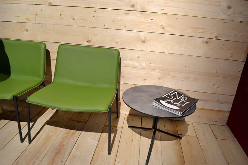 Avocado green leather upholstered chairs with contrast piping and steel frame
