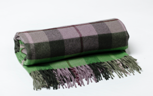 This limited edition cashmere and wool throw was created by European master craftsmen
